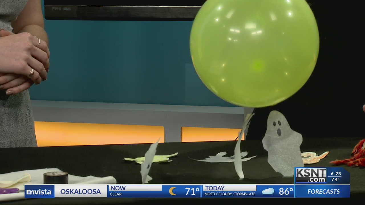Ghosts made of tissue paper being moved around with static electricity from a balloon