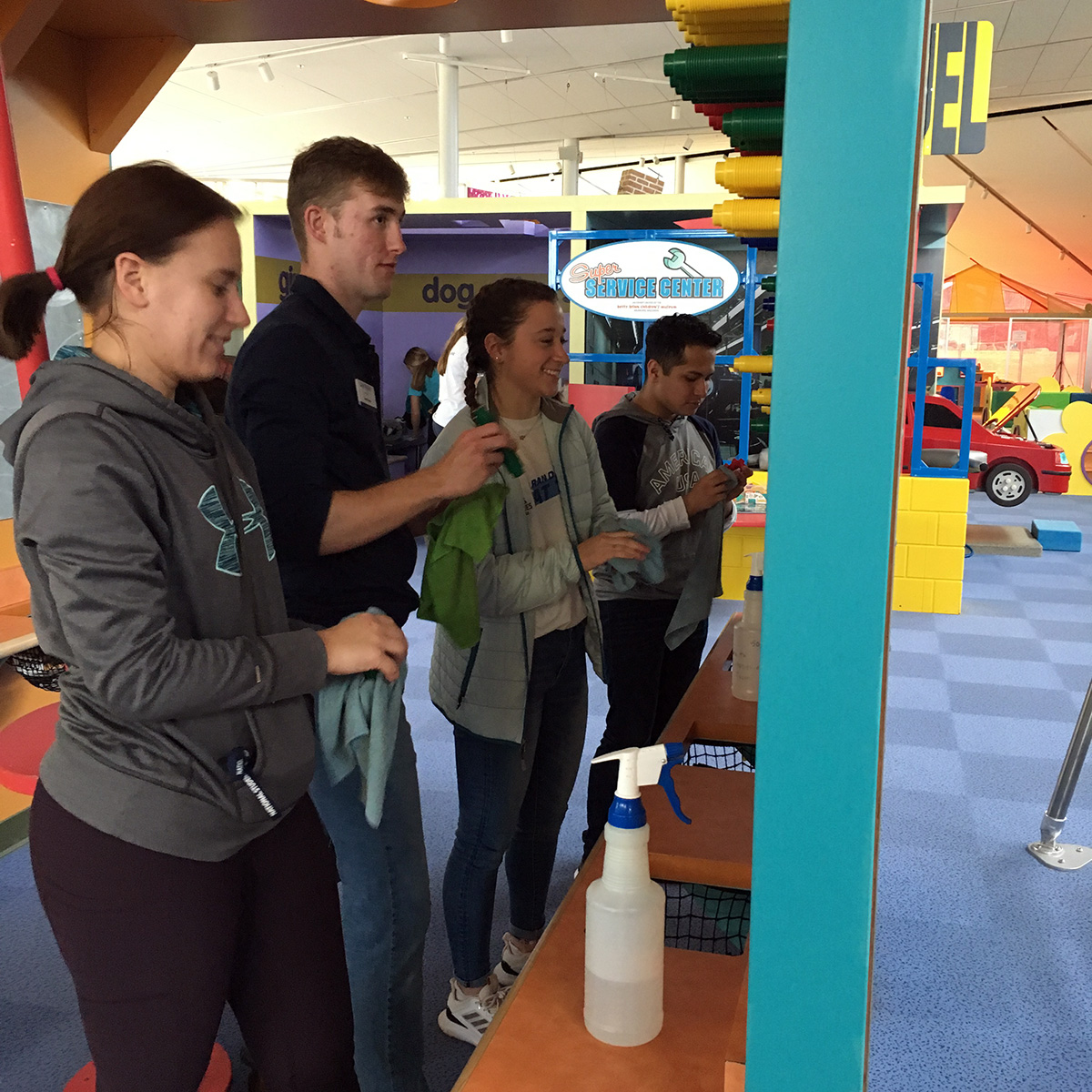 Washburn Leadership Institute volunteers clean magnetic toys