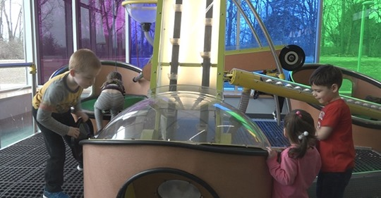 Children playing in the grain exhibit from WIBW