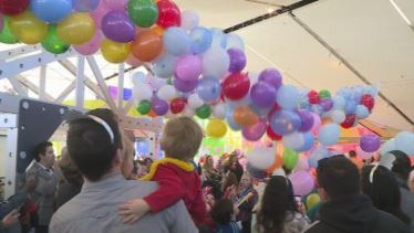 Image for Noon Years Even showing families as balloons drop from the ceiling from WIBW