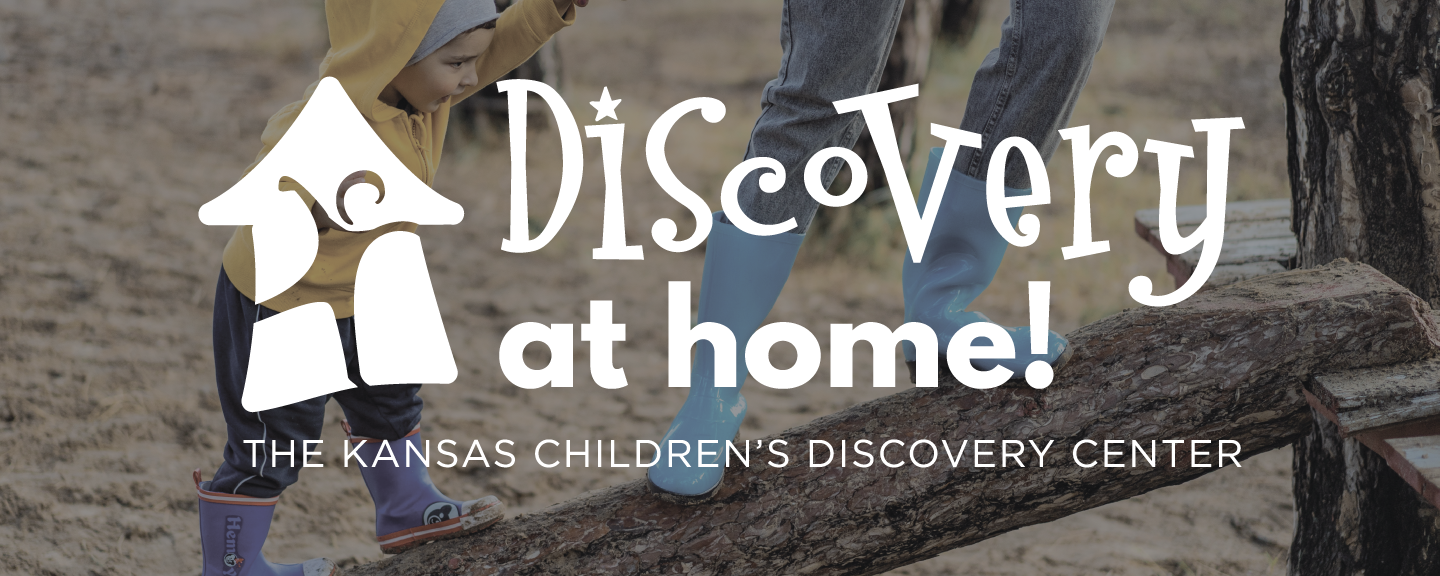 Discovery at Home logo with a small child in yellow jacket balances on a tree with someone in blue boots in the background